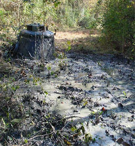 Overflowing sewer manhole