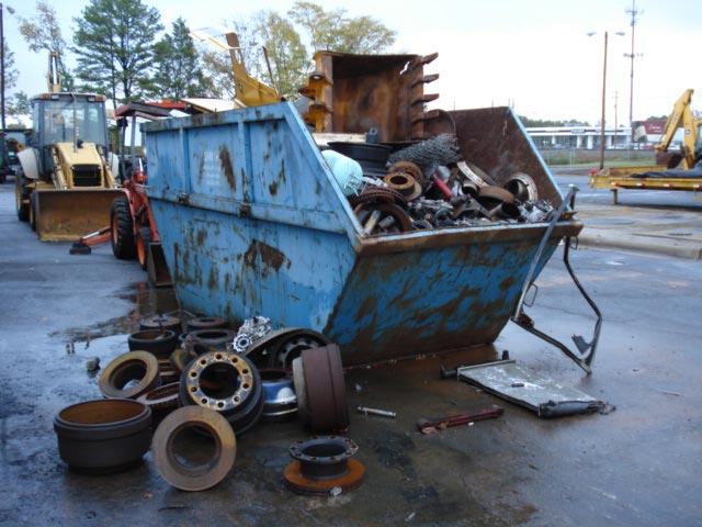 Overflowing/uncovered scrap metal bin